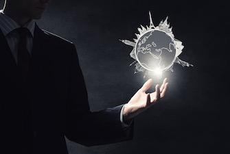 businessman-globe-hand-light