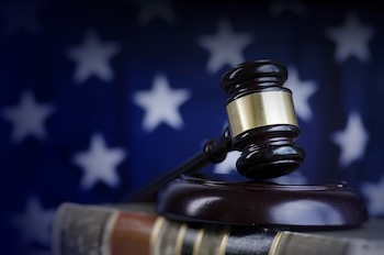 Gavel with american flag background